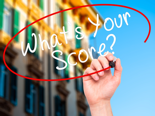 Hand writing What's Your Score – How to invest in real estate with poor credit