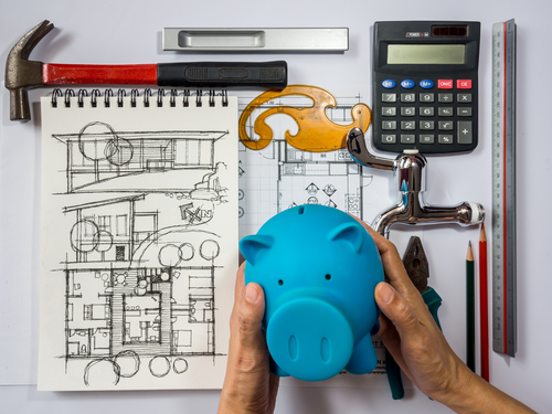 Piggy bank with home remodel planning tools � House flipping financing